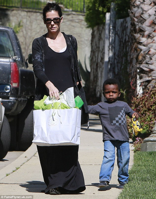 Bag full of goodies: Sandra and her two-year-old son Louis arrived with a bag full of gifts for Jackson
