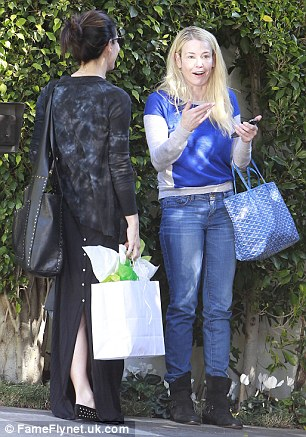 Good friends: Sandra Bullock and Chelsea Handler stopped by Jackson's first birthday party on Sunday at Charlize's home in Los Angeles