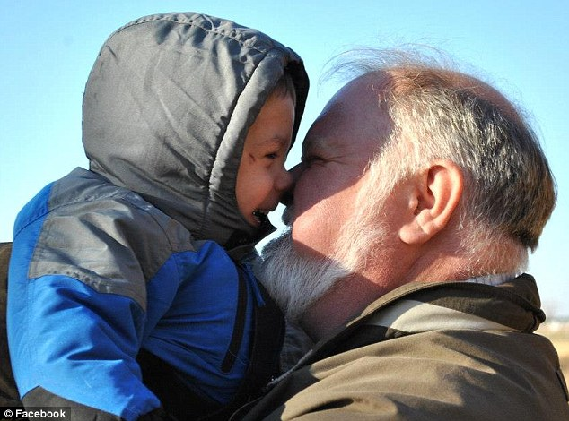 Look of love: Alan Shatto embraces his son, Maxim, in this photo. Max's parents wrote in his obituary, 'When we get to Heaven, we know we will hear your sweet voice singing with the angels. We love you and will always miss you'