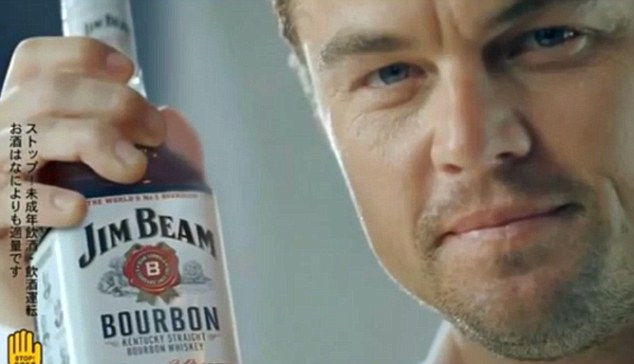 Beaming: Leonardo DiCaprio is believed to have pocketed millions to appear in a commercial for Jim Beam bourbon that will only air in Asia