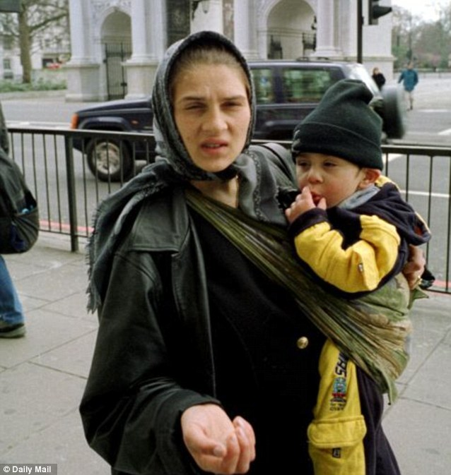 A Romanian beggar and her child at one of London's Marble Arch. Hundreds of thousands are expected to arrive, in a wave similar to the one that followed Poland's accession in 2004