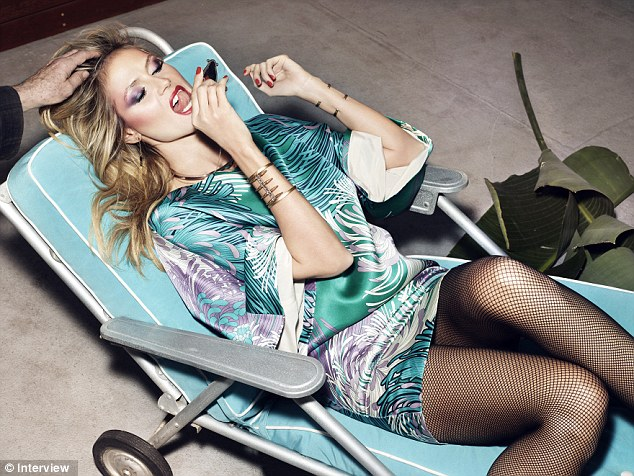 Stylish: Heidi Klum looks funky in the new edition of Germany's Interview magazine, shot by legendary British photographer Rankin