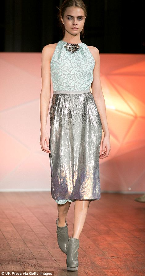 Silver sequin siren: Cara rocked lace and sparkle in icy hues to close the show