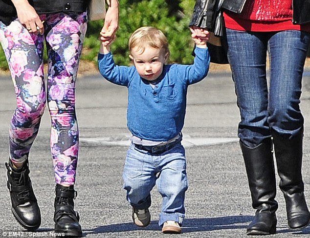 Having a ball: Little Xander had a ball as he tottered along holding Diane and his mother's friend's hand