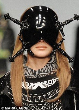 Funky head wear: The models donned a whole range of crazy get-ups from horns to knife adorned masks
