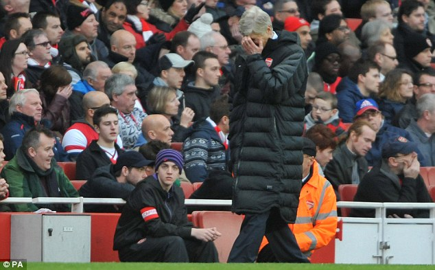 Over and out: Arsenal were dumped out of the FA Cup by Blackburn Rovers at the Emirates on Saturday