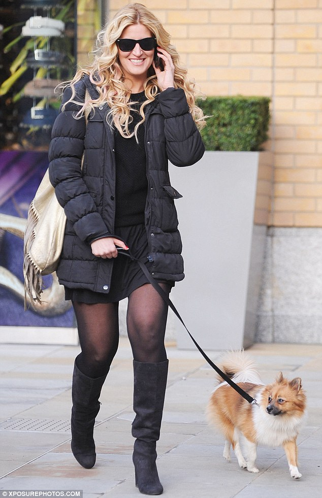 Pet pooch: Cheska took her dog out for a walk in West London on Tuesday and looked happy to strolling in the sunny weather