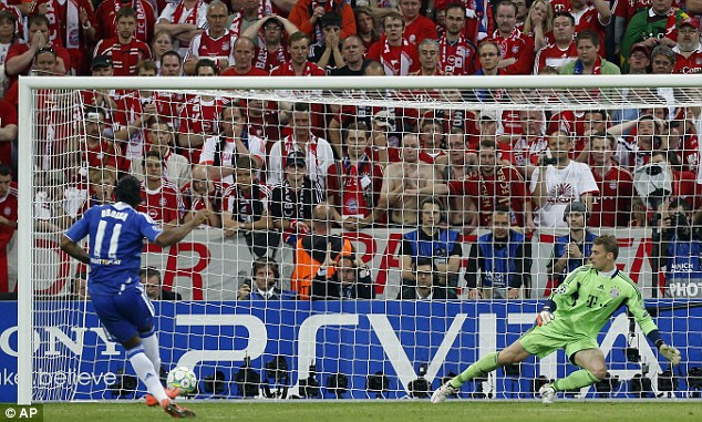 On the spot: Drogba also scored the winning penalty to complete Chelsea's stunning European triumph
