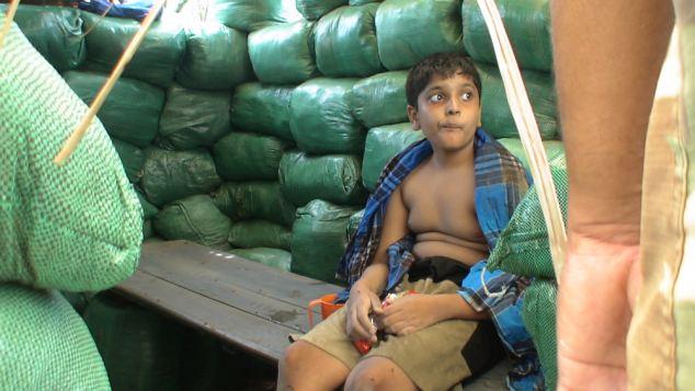 Balachandran Prabhakaran is seen apparently in Sri Lankan custody as he sits in a bunker and wrapped in a blanket