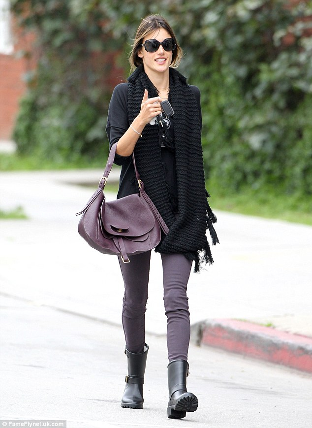 Purple angel: Alessandra sported plum-hued trousers and matching handbag; after dropping Anja in school, she took her fashionable self to get coffee