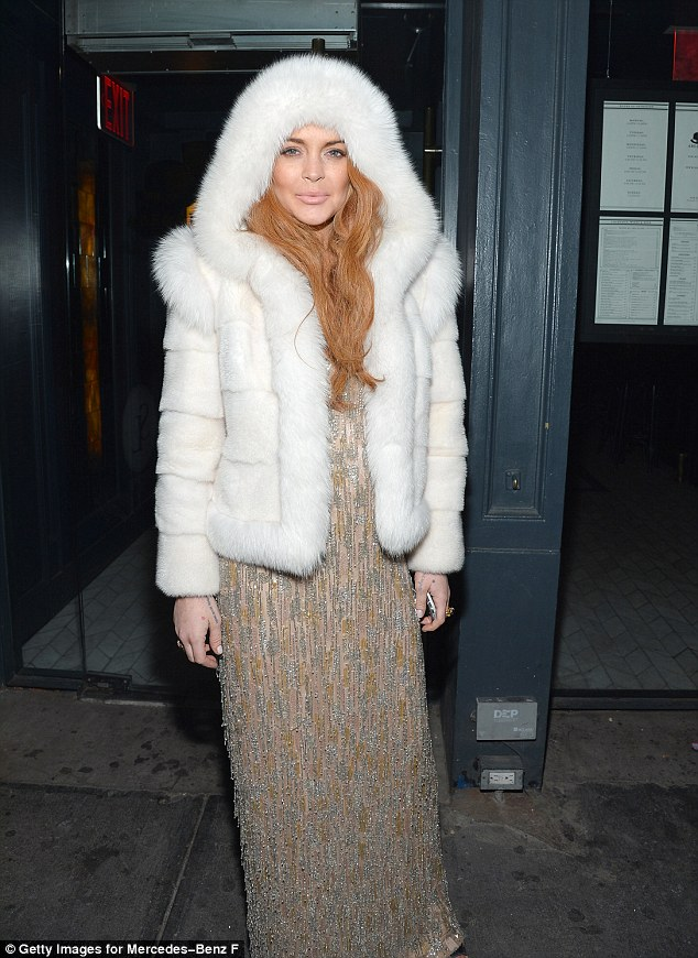 Still a party girl: Lindsay's problems with the law haven't prevented her from having fun at New York Fashion Week, as she did on February 6 at the amfAR gala