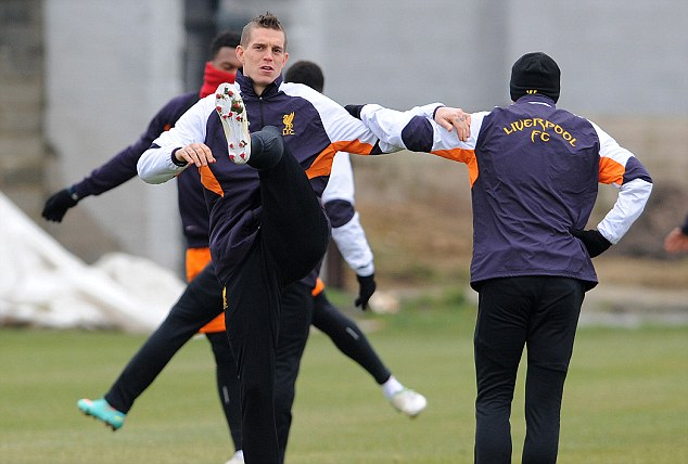 At full stretch: Daniel Agger limbers up during Liverpool's final training session before taking on the Russians