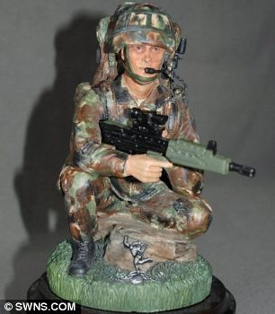 The toy soldier bought by Julie Lloy - its three-inch rifle was classed as a firearm by Gatwick security