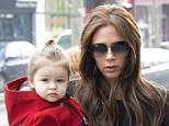 Mummy's little fashionista! Victoria takes in some of the sights with daughter Harper