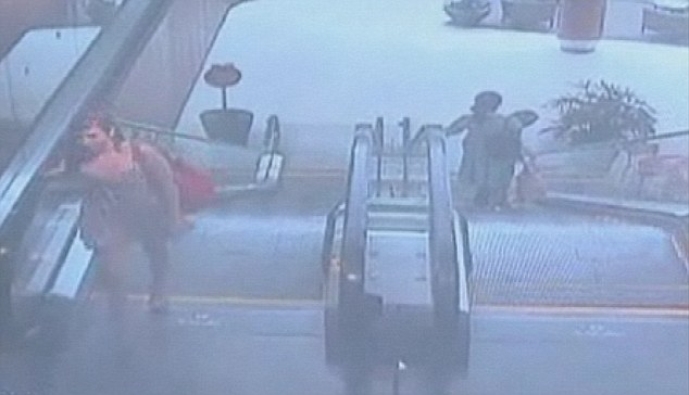 Carefree: CCTV captured Lauren Astley, 18, from Wayland, Massachusetts, leaving her job at Natick Mall and going home at 6.51pm on July 3, 2011