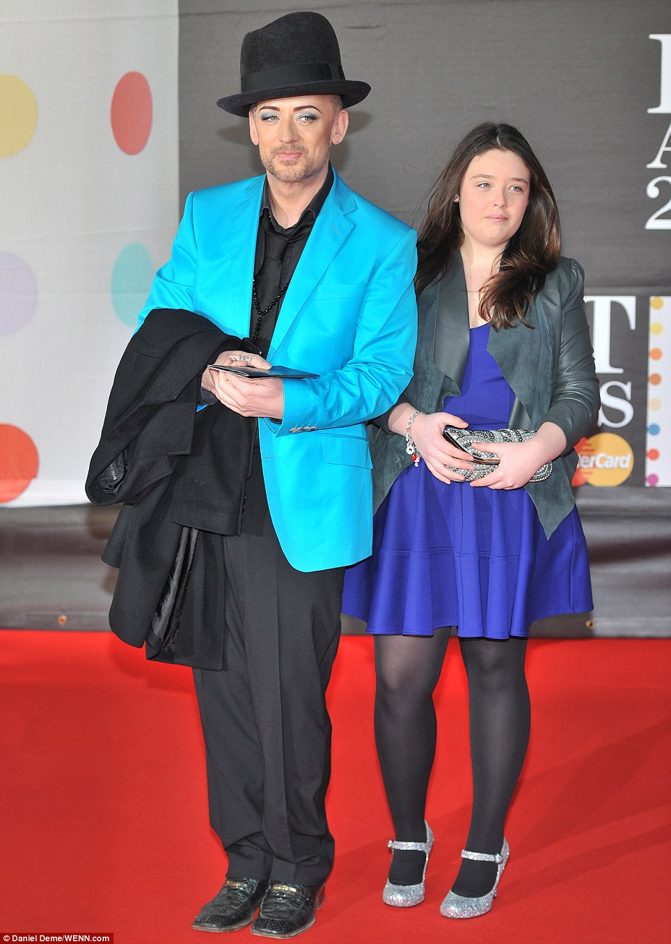 Mini Boy George: George O'Dowd showed off his new slimline look in a bright blue coat, co-ordinating with his niece who he brought along as his date to the proceedings