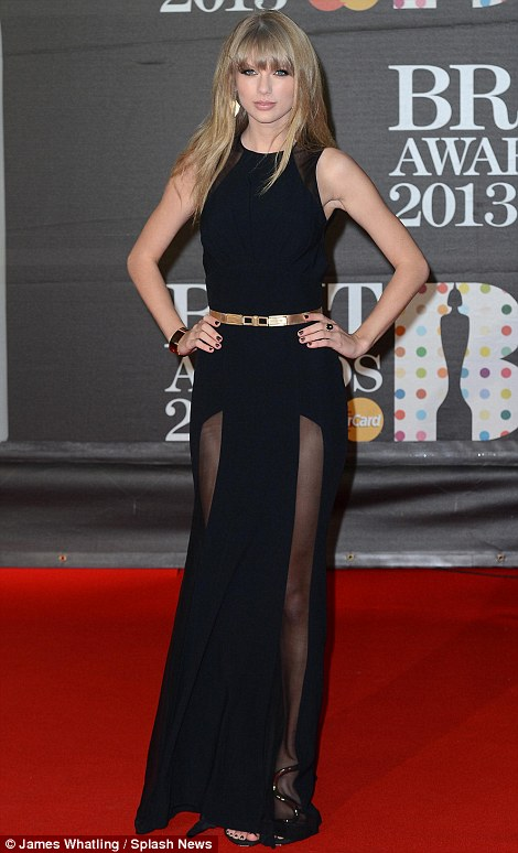 Lady in black: Swift also went for a daring number with her high cut sheer panels showing off her legs as she posed up for the cameras