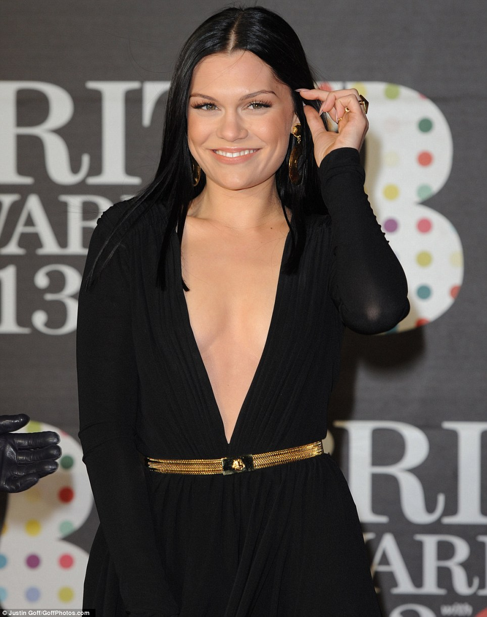 That's a bit daring! Jessie J leads the glamour on the Brit Awards red carpet on Wednesday night in a plunging black frock down to her naval as she joined the rest of the black dress brigade