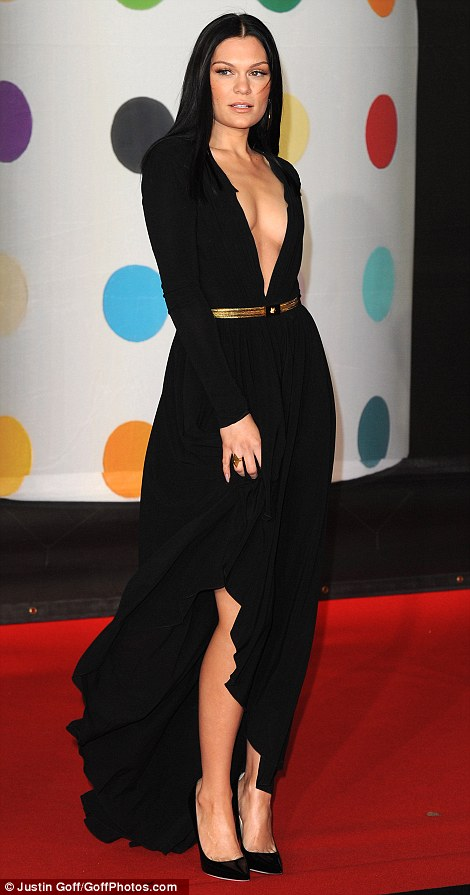 Making quite an entrance: She shunned her usual style of PVC catsuits and quirky fashion to doll herself up in the floorlength frock, which also flashed a bit of leg
