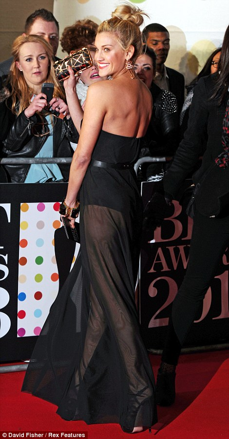 Miaow! Ashley Roberts showed off plenty of skin in a see through frock over a strapless leotard with a cinched in waist, which she confidently showed off