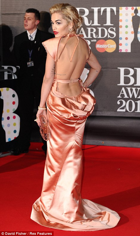 Not her usual style: Rita Ora was hoping for an award but didn't win the trophy for best dressed in her salmon backless Ulyana Sergeenko gown