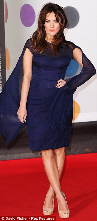 A sea of blue: Caroline Flack overcame her bout of food poisoning to attend in her navy floating frock, while Jo Whiley also went for blue and Katherine Jenkins committed a rare fashion fail in her printed frock