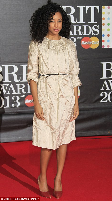 Of course she's there! Laura Whitmore opted for a metallic mini-dress by Zoe Jordan for the ceremony, showing off her slender bare legs as she was the first to make her way on to the red carpet