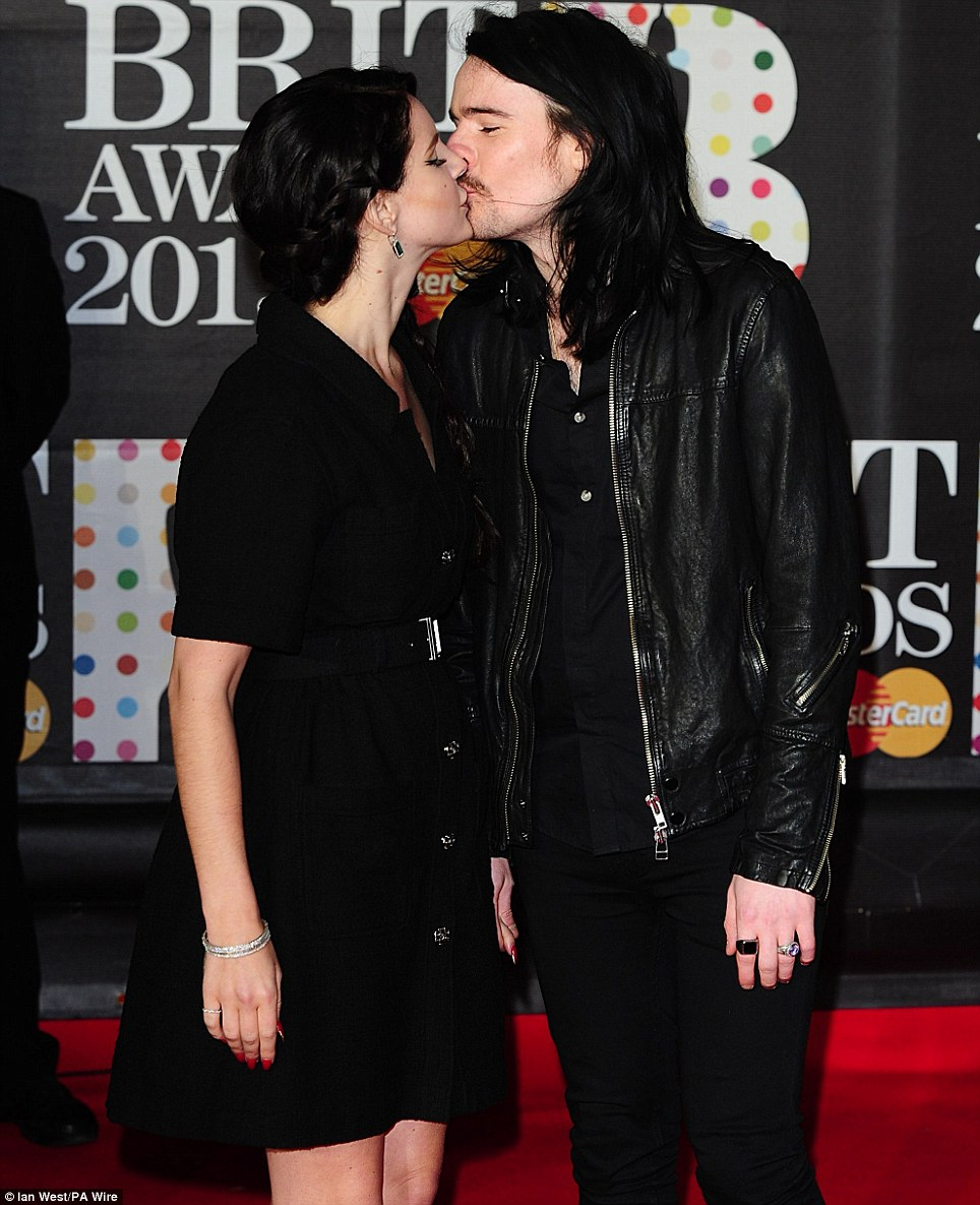Flaunting their love: Lana Del Rey puckers up to Barrie-James O'Neill, who she is rumoured to be engaged to after she flashed a ring on her engagement finger earlier this month