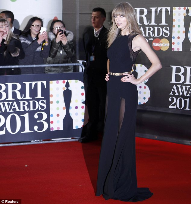Photographers darling! Taylor was the centre of attention thanks to her sophisticated outfit