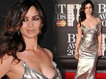 Bringing some Bond girl glamour: Bérénice Marlohe wears sheer silver dress with plunging neckline to Brit Awards