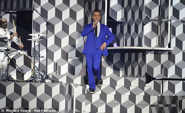 Shot of colour: Robbie stood out with his blue suit against the monochrome background