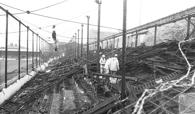Debris: Investigators search through the rubble at Valley Parade after the fire