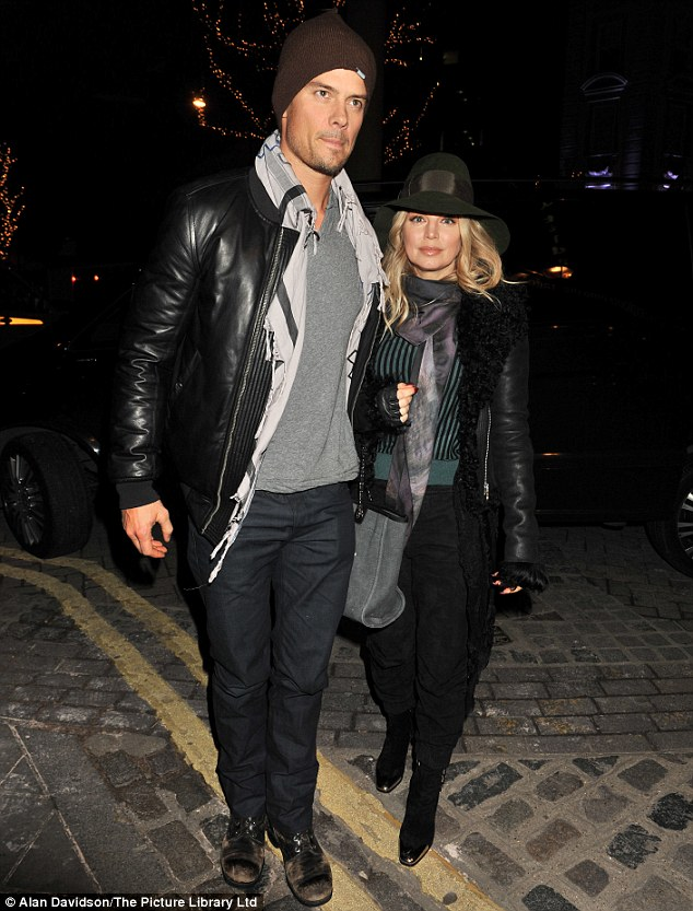 Coupled up: Josh Duhamel put a protective arm around his wife, Fergie, as they made their way to a London theatre on Wednesday