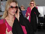 Pretty in pink: Brandi Glanville lands back in Los Angeles as she defends talking about her ex, 'I have to promote my book'