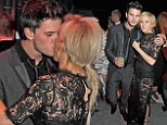 It's love on the dancefloor! Ellie Goulding and Jeremy Irvine pucker up at Universal Music Brits afterparty