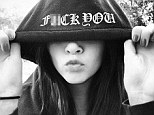 Act of rebellion: Kendall Jenner tweeted a picture of herself to the 'haters' on Thursday, making a kissy face with the words 'f*** you' on her clothing