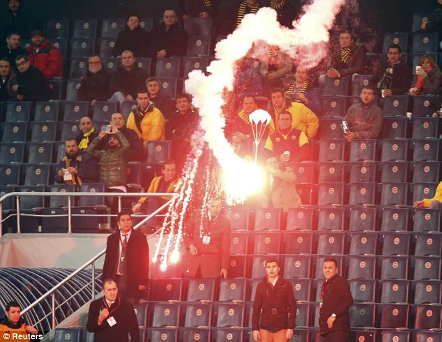 Fireworks: A flare on a parachute falls onto the pitch