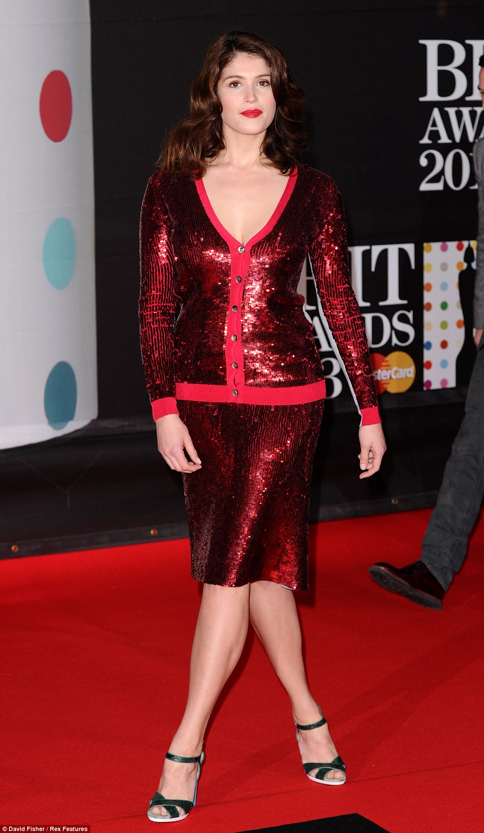 Shining bright: Gemma Arterton lead the glamour at the 2013 BRIT Awards as she walked the red carpet in a sequin shirt dress and matching rouge lipstick