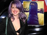 'I got my shoe stuck in a drain!' Kelly Osbourne shows off her sprained ankle in a colourful brace