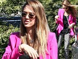 Donning a hot pink menswear-inspired blazer atop a loose black blouse and her trendy jeans, the actress looked far from the usual office worker.