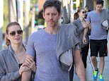 Is she afraid he'll fly away? Amy Adams keeps fiance Darren Le Gallo grounded with a tight grip on way to the gym