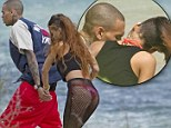 Ex rated! Rihanna slips into wildly inappropriate fishnet stockings to celebrate her birthday with Chris Brown in Hawaii