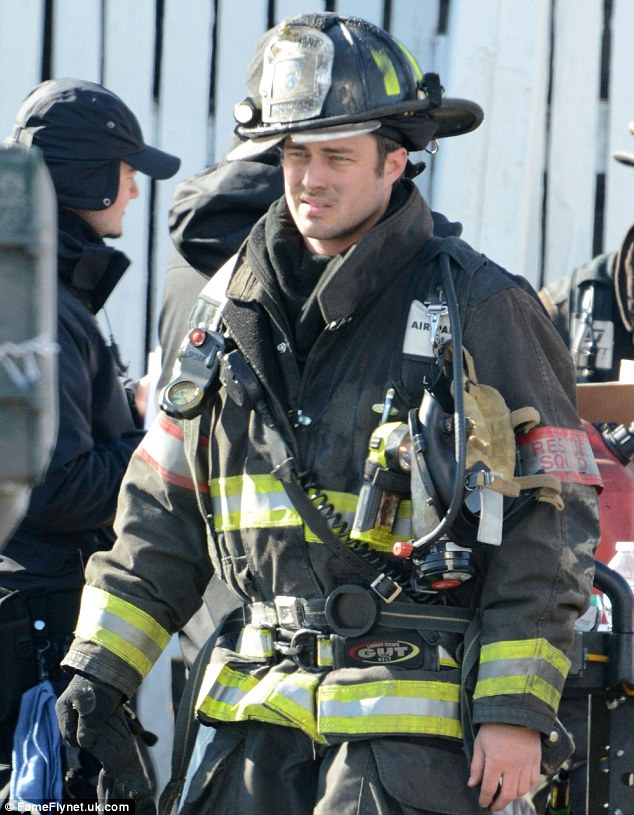 Keeping busy: While his girlfriend was in surgery, Taylor Kinney was busy filming scenes of Chicago Fire in Chicago
