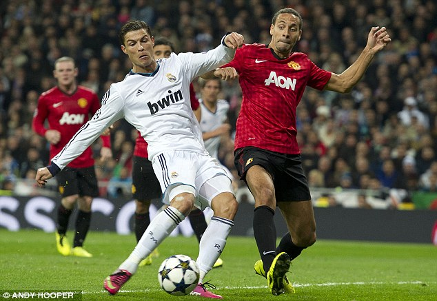 Solid: Ferdinand put in a superb performance as Manchester United drew with Real Madrid in the Bernabeu