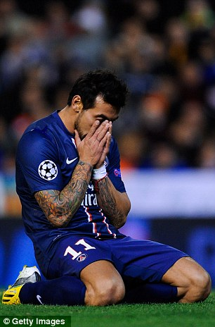 Ezequiel Lavezzi of Paris Saint-Germain reacts after missing a chance to score during the UEFA Champions League Round of 16 first leg match against Valencia CF