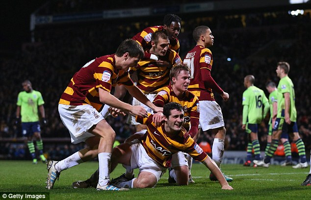 Cup of joy: McHugh (centre) is mobbed after scoring against Aston Villa in the semi-final