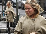 Making a dash for it! Sienna Miller sprints along as she attempts to avoid getting wet in the New York rain