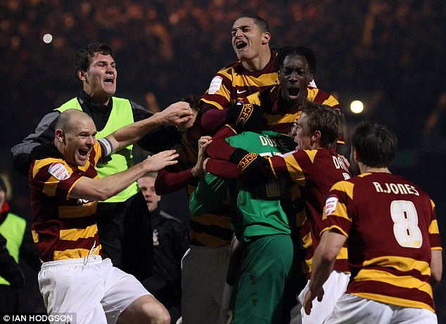 Memorable night: Bradford celebrate after famously seeing off Arsenal on penalties in December
