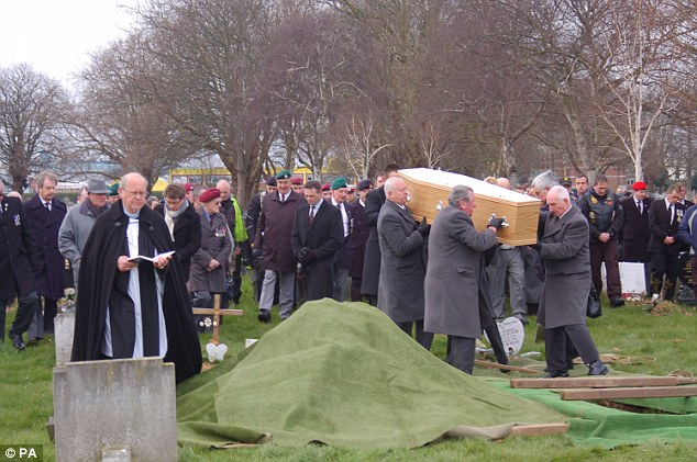 Coffin carried: The Reverend Bob Mason is seen (left) at the funeral of former Royal Marine James McConnell