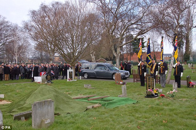 Mark of respect: A small procession through the cemetery for Mr McConnell, who died of a chest infection, was led by Royal British Legion standard bearers